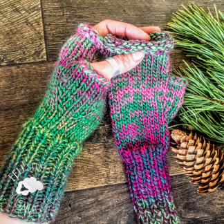 Hand knitted fingerless gloves in greens and pinks