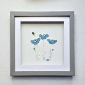 framed picture of forget me nots made from tiny nuggets of sea glass