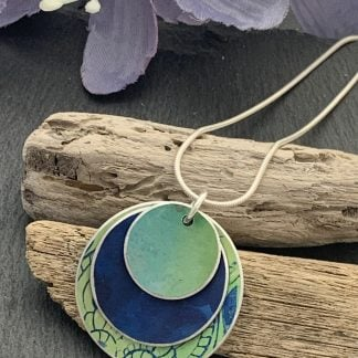 lime green and blue peacock print pendant