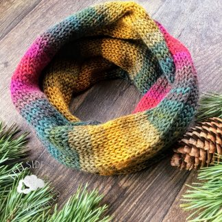 Knitted infinity scarf in autumn rainbow