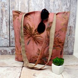 Reversible tote with a terracotta palm print on one side and a stripe on the other