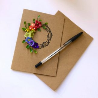 Greetings card with an image of a wreath