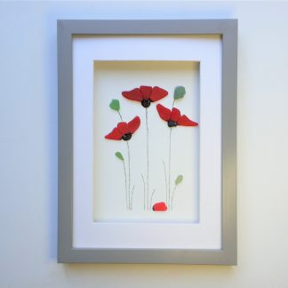 framed picture of three red poppies made from Cornish sea glass