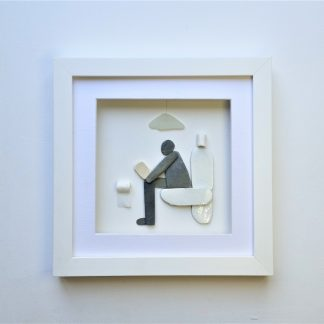 framed picture of a pebble art man sitting on a toilet