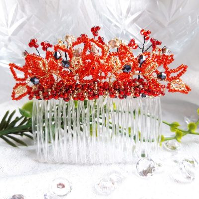Red and gold hair comb from the Radiance Collection.