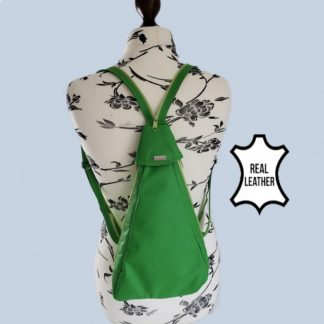 green leather backpack on mannequin