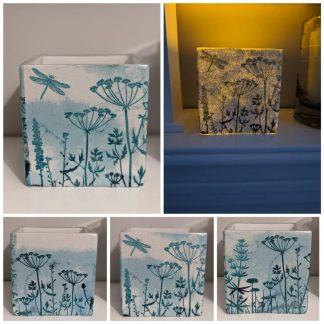 Large, square glass decoupaged tealight holder with a blue misty meadow and dragonfly design