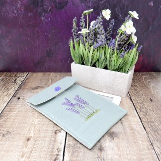 Handmade green linen kndle case with hand embroidered lavender flowers