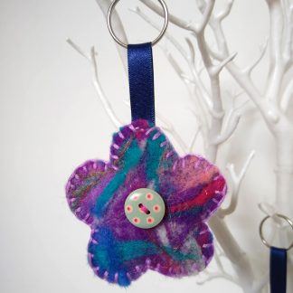 Front of the mini handmade needle felted flower keyring by Oh Sew Creative
