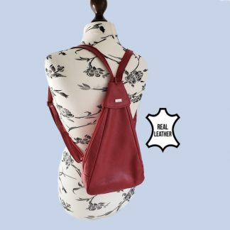 red leather backpack on mannequin