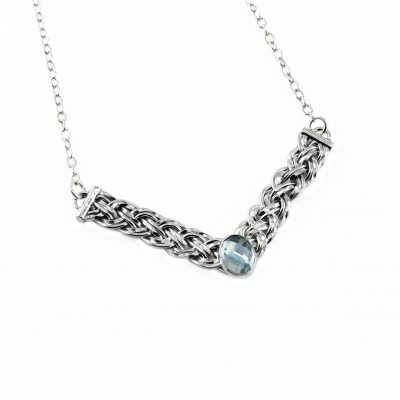Sterling silver basket weave V shaped necklace with sky blue topaz isolated on a white background