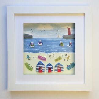 framed picture of beach huts and a busy beach scene made from beach combed bits and pieces
