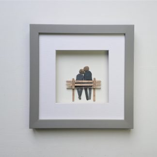 framed pebble art picture of couple on a wooden bench