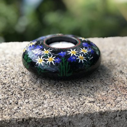 Round tea light holder with hand painted edelweiss and gentian violets side view