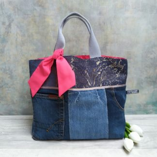 Recycled denim and blue brocade grab bag with pink lining and trim. Pictured with white tulips