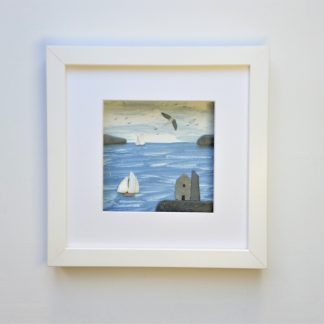 framed picture of a Cornish tin mine and tall ships made from beach finds