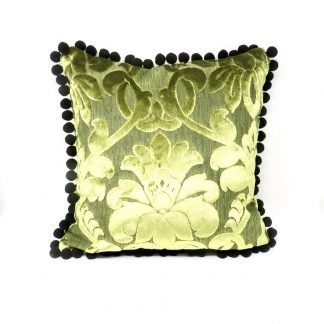 Luxurious cushion handmade in chartreuse velvet and with a black pom pom trim