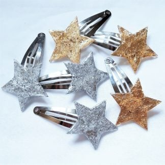 Shiny silver and gold star hair clips