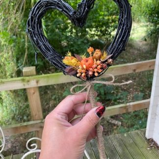 Autumnal heart shaped floral wand decoration