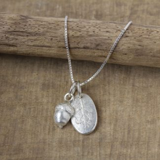 Handcrafted Hollow Acorn and oval oak leaf pendants on sterling silver jump rings
