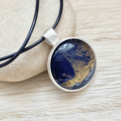 hand painted art pendant in shades of blue and gold