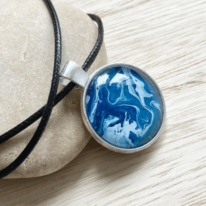 art pendant in shades of blue
