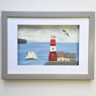 framed picture of lighthouse and sailing boats made from beach combed finds