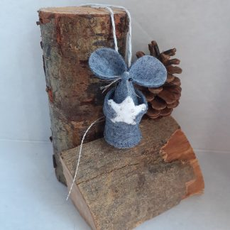 A handmade felt Mouse holding a white felt star decorated with silver beads
