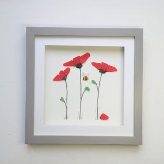 framed picture of three red poppies and a bee made from Cornish sea glass