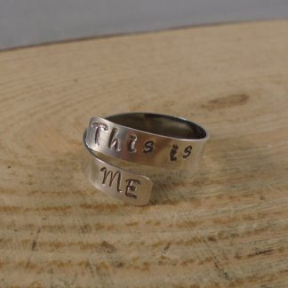 sterling silver adjustable ring stamped with this is me on either end