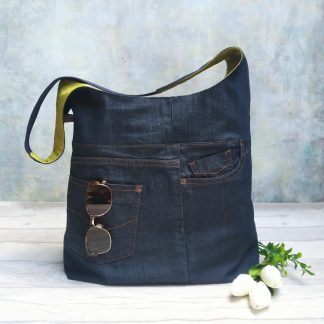 Upcycled denim large hobo bag pictured with sung;asses and tulips