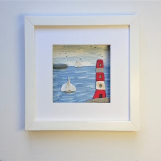 framed picture of a lighthouse made from sea pottery and sea glass beachcombed finds
